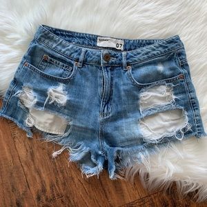 GARAGE Festival high rise ripped Jean short size 7
